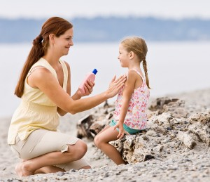 bigstock-Mother-applying-sunscreen-to-d-27198983