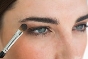 bigstock-Woman-getting-made-up-with-eye-39374254