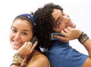 bigstock-Young-couple-using-a-mobile-ph-27002174