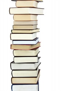 bigstock-books-stack-isolated-on-the-wh-27223379